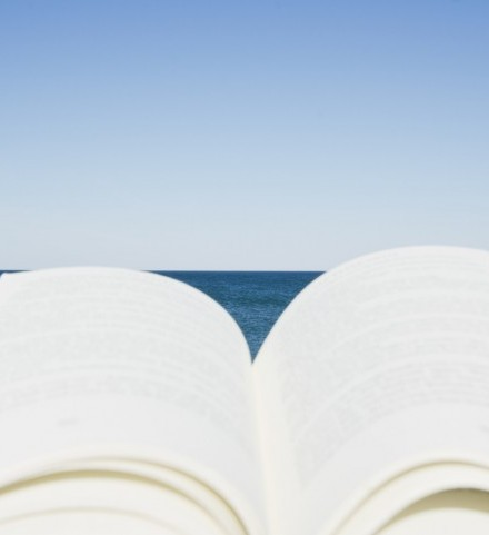 Open book on beach